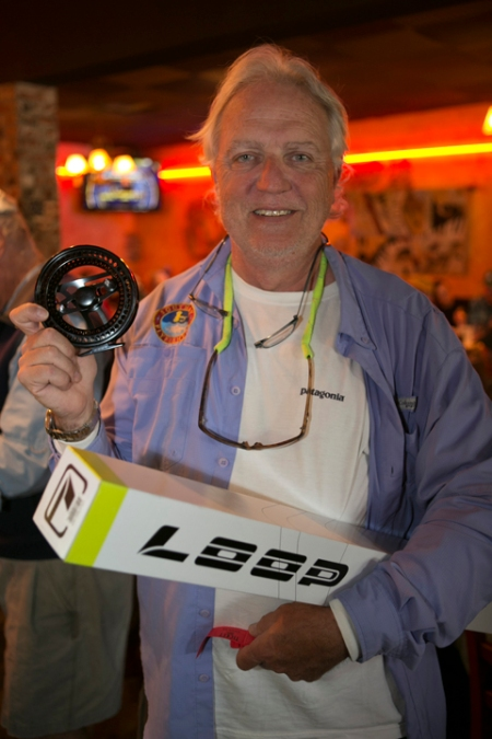 Mike Grovenor wins big raffle prize from LOOP, valued at close to $1600. photo by Jorge Salas