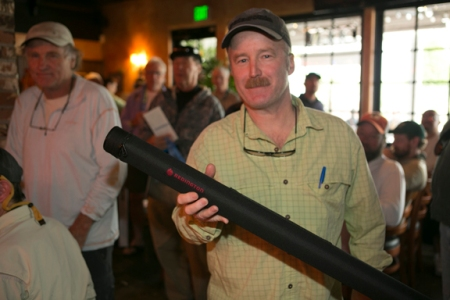 Tim Postel with a Redington 7weight Vapen he won in the raffle. Photo by Jorge Salas